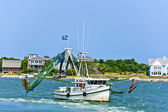 Small fisherboat heading to the ocean catching fish — Stock Photo