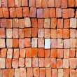 Red stapled bricks give harmonic pattern in sun — Stock Photo #7871501