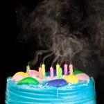Birthday cake candle smoke — Stock Photo