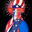 Patriotic man and fireworks — Stockfoto