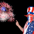 Patriotic man and fireworks — Stock Photo