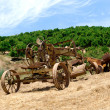 Antiquated farming equipment - Stock Photo