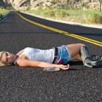 Blond drunk on highway — Stock Photo