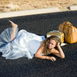 Bride laying in street - Stock Photo