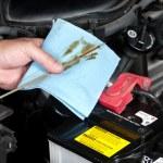 Auto Mechanic Checking Oil — Stock Photo #7452791