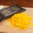 Freshly grated cheese - Stock Photo