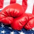Boxing gloves on American flag - Stock Photo