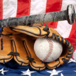 Baseball equipment on American flag — Stock Photo #7453037