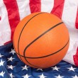 Basketball on American Flag — Stock Photo
