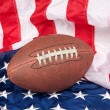 Football on American Flag - Stock Photo