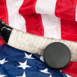 Stock Photo: Hockey equipment on Americflag