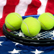 Tennis equipment on American flag — Stock Photo #7453056