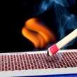 Matchstick on fire - Stock Photo