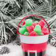 Decorative pail of Christmas candy — Stock Photo #7453313