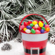 Decorative pail of Christmas candy — Stock Photo