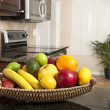 Basket of fresh fruit in modern kitchen — Stock Photo #7453348
