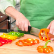 Woman Slicing Bell Peppers — Stock Photo #7453381