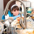 Stock Photo: Homemaker washing dishes