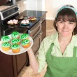 Stock Photo: Homemaker holding cupcakes