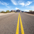 Long desert road - Foto Stock