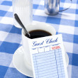 Blank check in diner — Stock Photo