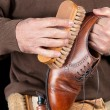 Stock Photo: Shoeshiner