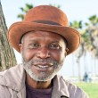 Elderly black man smiling — Stock Photo