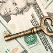 Skeleton key on cash. — Stock Photo