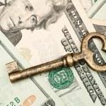 Skeleton key on cash. — Stock Photo
