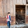 Patriotic boy and old barn — Stock Photo #7453969