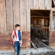 Patriotic boy and old barn — Stock Photo