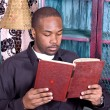 Black man reading a book — Stock Photo
