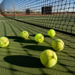 Tennis balls and court — Stock Photo