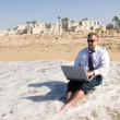 Businessman on beach working — Stock Photo