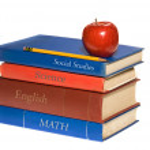 School books and apple — Stock Photo