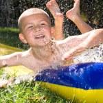 Water slide and kid — Stock Photo #7454572