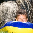 Kid on water slide — Stock Photo