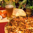 Italian pizza and cold beer - Stock Photo