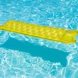 Royalty-Free Stock Photo: Yellow raft floating in a pool