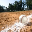 Baseball on chalk line — Stock Photo #7454674