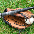 Baseball equipment on grass — Stock Photo