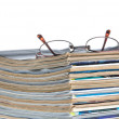 Stack of old magazines & reading glasses — Stock Photo
