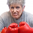 Stock Photo: Grandmother and boxing gloves