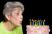 Adult blowing out candles — Stock Photo