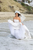 Asian bride at the beach — Stock Photo