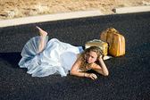 Bride laying in street — Stock Photo