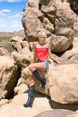 Country girl in desert — Stock Photo