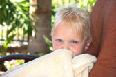 Boy wrapped in towl — Stock Photo