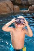 Boy playing in pool — Stock Photo