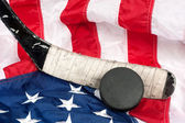 Hockey equipment on an American flag — Stock Photo